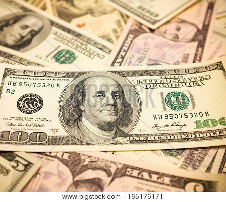 Pile of one hundred dollars bills background