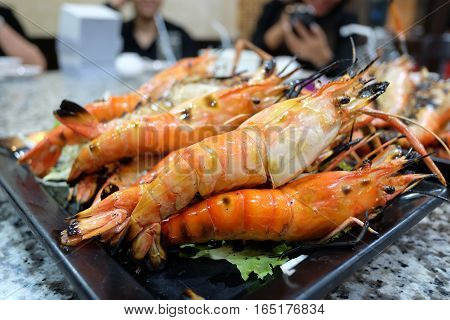 grill shrim seafood on black dish table