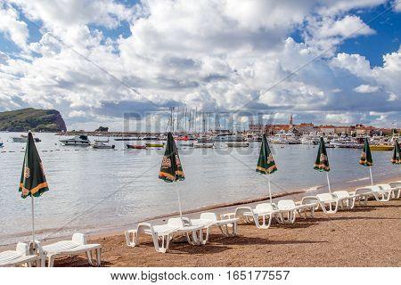 BUDVA, MONTENEGRO - SEPTEMBER 19, 2016:Sun loungers and umbrellas are on the beach in Budva, Montenegro.