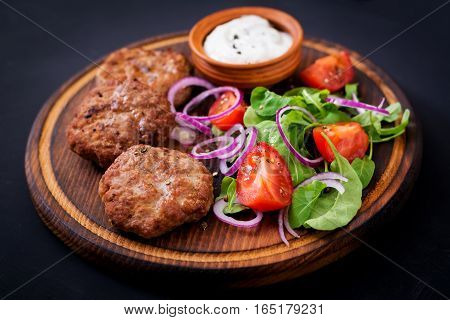 Appetizing Meat Cutlet And Tomato Salad With Arugula