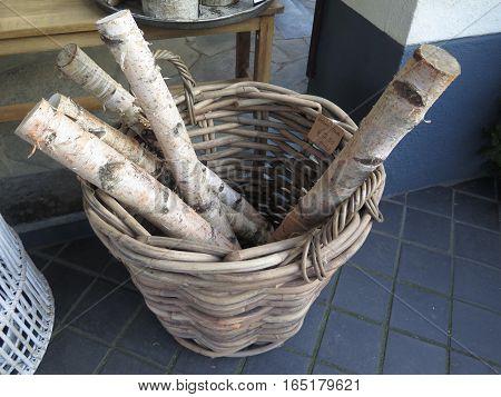 Small Wicker Basket with thin Birch logs