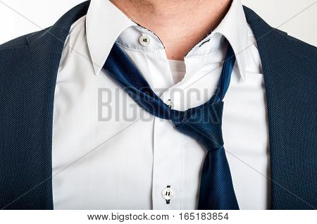 Man is loosening a tie after hard work