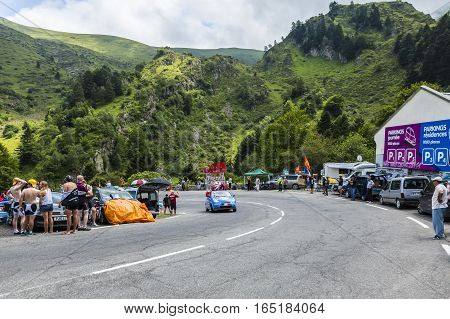 Col du Tourmalet, France - July 24, 2014: X'tras caravan during the passing of the Publicity Caravan on the road to Col de Tourmalet in the stage 18 of Le Tour de France 2014.