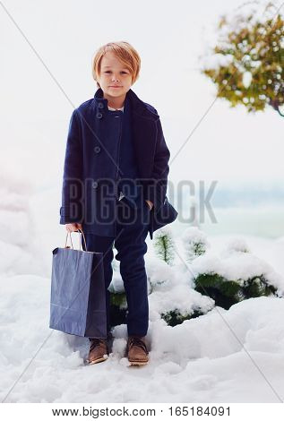 Fashionable, Seven Years Old Boy In Coat, Holding Bag Outdoors
