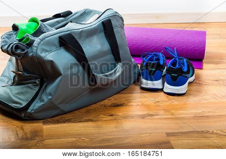 Sport bag sport shoes on wooden floor