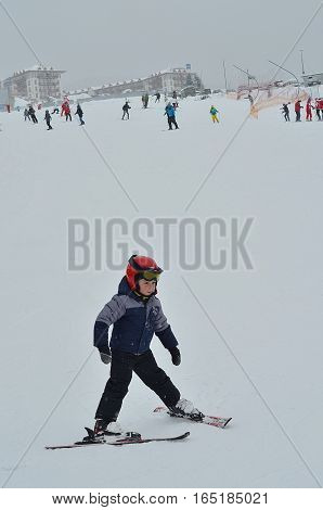 BUKOVEL, UKRAINE - December 2, 2016: skier boy ready to downhill. Bukovel is the most popular ski resort in Ukraine. Winter ski