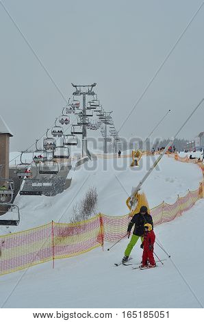 BUKOVEL, UKRAINE - December 2, 2016: Skiers  on ski slope. Bukovel is the most popular ski resort in Ukraine.