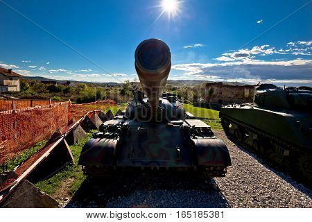 Military Tank Silhouette With Sun Rays