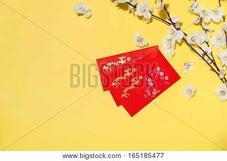 Chinese New Year Decoration Items On Yellow Background. Text Mean Lucky And Getting Rich