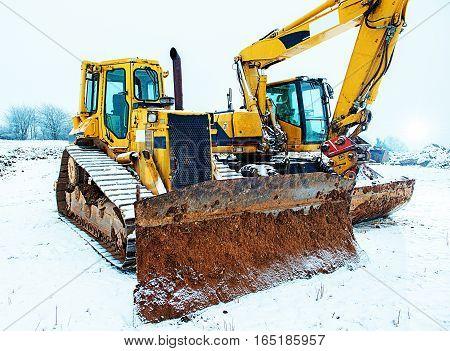Power Shovel And Bulldozer In Snow