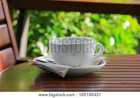coffee cup on the wood floor background