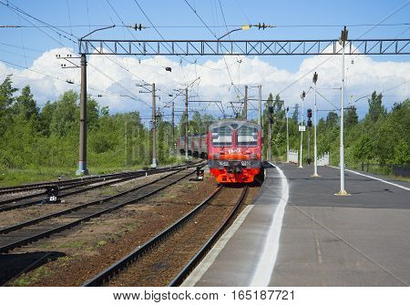 LENINGRAD REGION, RUSSIA - JUNE 08, 2015: The train departs from the station Petrokrepost. Leningrad region