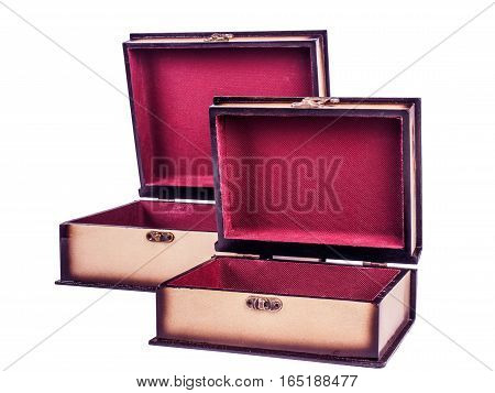 Picture of two opened wooden jewel-box with red fit-out isolated on white background. Handmade boxes for bijouterie. Side view.