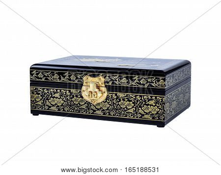 Picture of the wooden jewel-box with painting on wood and golden lock isolated on white background. Painted pattern on a closed box for bijouterie. Side view.