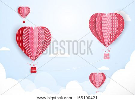 Hot air balloons in shape of heart flying in clouds. paper art and cut origami style