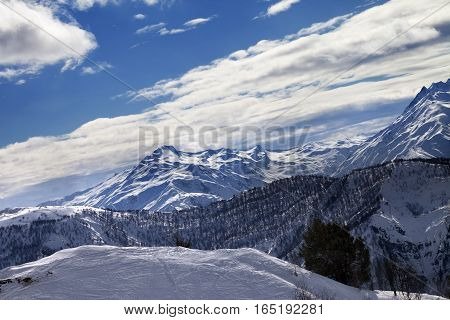 Off-piste Slope And Snow Winter Mountains In Sun Evening
