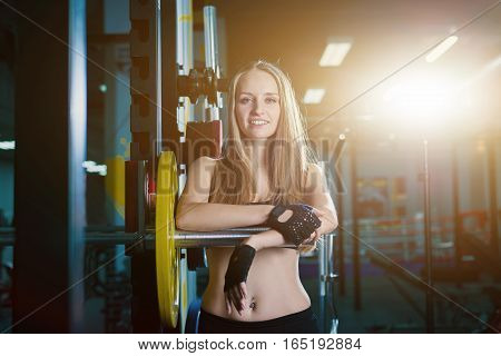 Attractive Sporty Woman Exercising With Barbell In Gym. Beautiful Fitness Girl Resting After Sport W