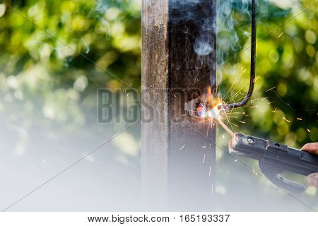 Welder in factory welding metal at Construction site