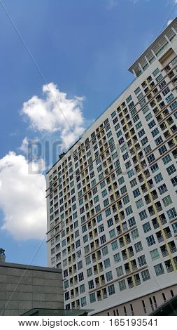 Apartment building with the blue sky and beautiful cloud.