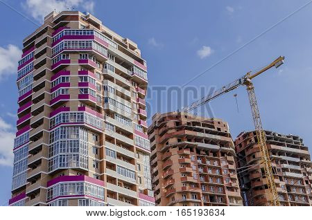 Close-up of under construction residential buildings of pink and brown
