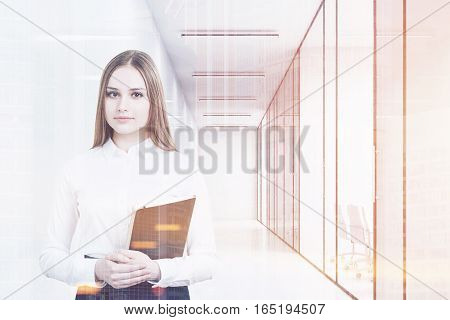 Young girl in an office suit is holding a black folder and standing in a white office corridor with conference rooms. 3d rendering. Mock up. Toned image. Double exposure