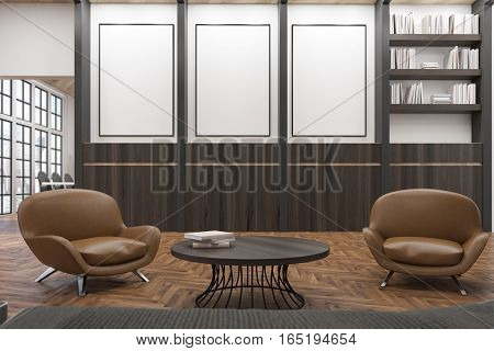 Office waiting room with two comfortable dark leather armchairs near a round coffee table. There is a bookcase and three vertical posters. 3d rendering. Mock up