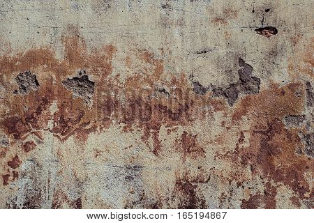 Detail of a weathered plastered wall with stains Old plaster walls  close up detail of textured rustic terracotta stucco wall.