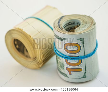 Roll of hundred dollars success or financial concept