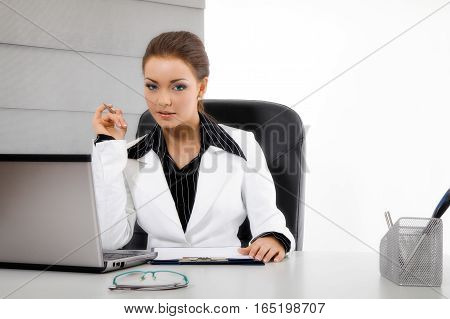 Young business woman with computer. Business concept