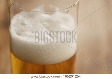 macro shot of lager beer in a glass with copy space