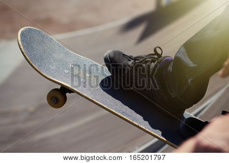 Skater Ready To Roll-in On A Quaterpipe