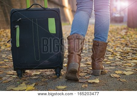 woman tourist traveling on the streets of European cities in the autumn