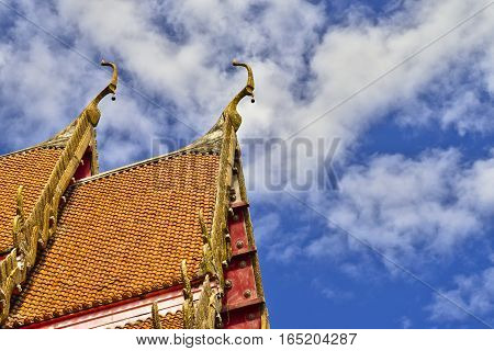 Roof style of Thai temple with gable apex on the top with blue sky and white cloud