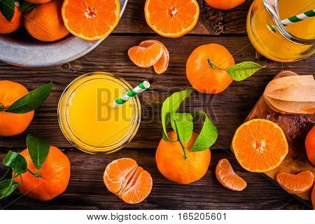 Freshly Squeezed Mandarin Juice In Glass On Wooden Table