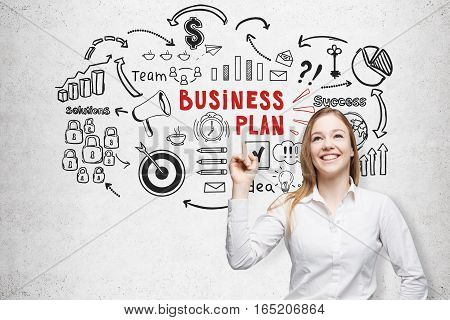 Cheerful Blond Woman And A Business Plan Sketch