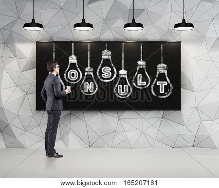 Side view of a businessman with a paper coffee cup looking at a large white consult and light bulb sketch drawn on a blackboard. Geometric wall pattern. 3d rendering