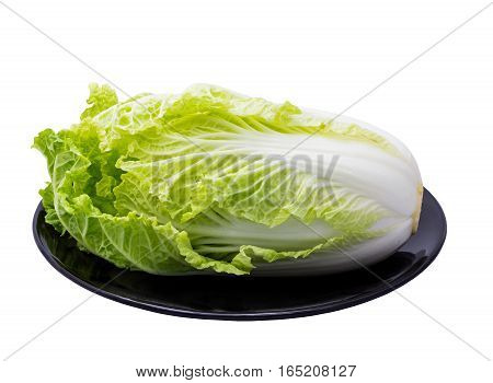Fresh 'Chinese Cabbage' is on the black dish isolated on white background