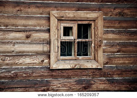 Window in wooden wall, russian retro house