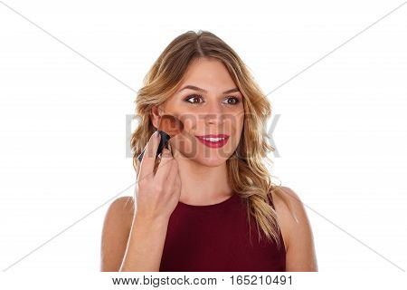 Picture of a beautiful young woman doing her make-up