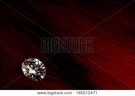 Beautiful big diamond jewelry on dark red background. Fine natural precious stone.Brillant shine.