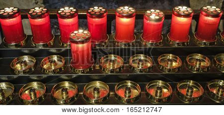 AGLIATE, ITALY - NOVEMBER 1, 2016: Agliate Brianza (Monza Lombardy Italy): interior of the medieval church of Saints Peter and Paul built from the 11th century candles
