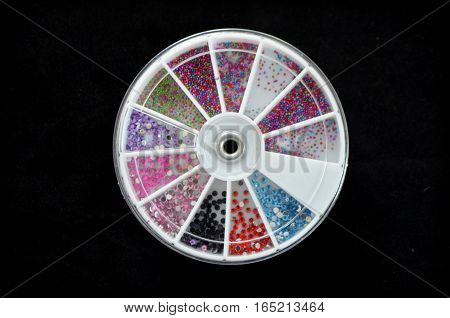 Colourful decorations for decoration of nails - a procedure in a beauty salon