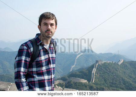Tired Man At The Great Wall Of China