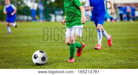 Soccer Football Match. Kids Playing Soccer. Young Boys Kicking Football Ball on the Sports Field. Kids Playing Soccer Tournament Game on the Pitch. Youth European Football Match