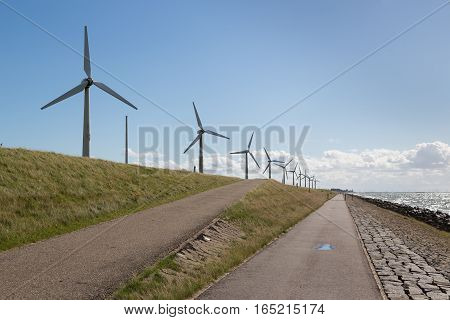 Windturbines along a Dutch dike near Urk