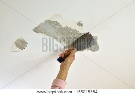 Removing Plaster With A Spatula