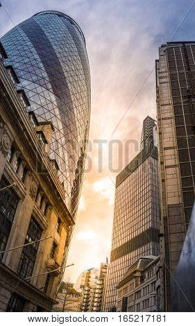London, UK - April 3, 2016. The sun setting behind 30 St Mary Axe, also known as The Gherkin Building at late afternoon.
