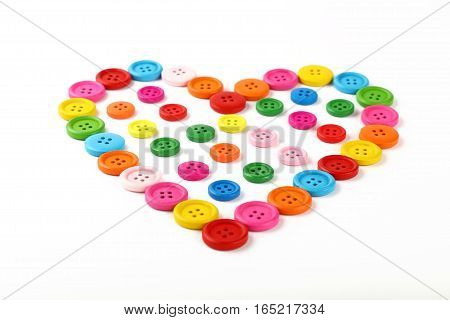 Heart Shaped Of Colorful Sewing Buttons On White
