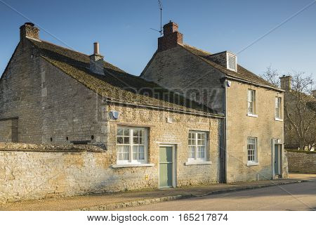 An image of two country cottages situated in the village of Duddington Northamptonshire England UK