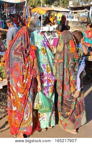 AHMEDABAD, GUJARAT, INDIA - DECEMBER 17, 2013: Women dressed with colorful saris at a market